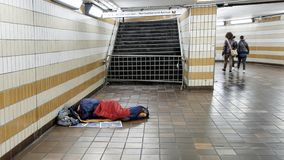 Homeless man sleeping in an underground tunnel Stock Photo