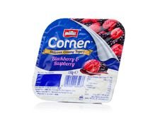 LONDON, UK - OCTOBER 27, 2017: Muller corner yogurt with blackberry and raspberry on a white. Stock Photography