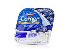 LONDON, UK - OCTOBER 27, 2017: Muller corner yogurt with blueberry on a white. Royalty Free Stock Images