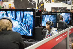 LONDON, UK - OCTOBER 26: Players testing previews of games to be Royalty Free Stock Image