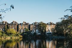 Row of semi-detached houses in Hampstead, facing a pond in Hampstead Heath, London, UK. royalty free stock photos