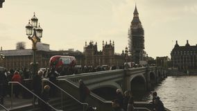 London, UK - October 20, 2017: Sliding shot from right to left of Big Ben and houses of Parliament during conservation refurbish. London, United Kingdom stock video footage