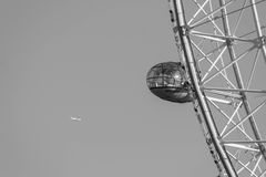 LONDON, UK - October 17th, 2017: Close up of the London Eye in London, England with tourist holding capsule in view. Royalty Free Stock Photo