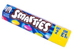 Packet of Smarties. LONDON, UK - OCTOBER 10TH 2017: A studio shot of a tube of Smarties over a plain white background, marufactured by the Nestle company on 10th Royalty Free Stock Image