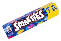 A Packet of Smarties. LONDON, UK - OCTOBER 10TH 2017: A studio shot of a tube of Smarties over a plain white background, marufactured by the Nestle company on Stock Photo