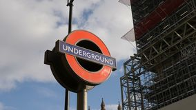 London, UK - October 20, 2017: The `Underground` sign in `Big Ben` and houses of Parliament background during conservation refurbi. London, United Kingdom stock footage