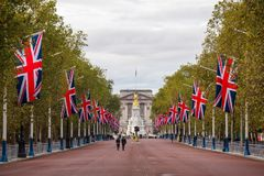 The Mall decorated with Union Jack flags London UK. LONDON, UK - OCTOBER 28, 2012: A view along the Mall decorated with Union Jack flags towards Buckingham Royalty Free Stock Photo