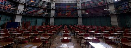 Panorama of the Octagon Library at Queen Mary, University of London in Mile End, East London, with colourful leather bound books stock image