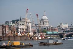 London UK. Panoramic vew of the iconic dome of St Paul`s Cathedral, the River Thames, cranes and buildings under construction. Photo of London UK. London skyline Stock Images