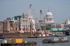 London UK. Panoramic view of the iconic dome of St Paul`s Cathedral, the River Thames, cranes and buildings under construction. Photo of London UK. London Stock Image
