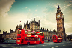 London, the UK. Red bus and Big Ben. London, the UK. Red bus in motion and Big Ben, the Palace of Westminster. The icons of England in vintage, retro style royalty free stock photography