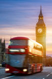 London, the UK. Red bus in motion and Big Ben, the Palace of Wes Stock Photo