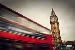 London, the UK. Red bus in motion and Big Ben Stock Images