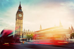 London, the UK. Red buses and Big Ben, the Palace of Westminster. Vintage Stock Images