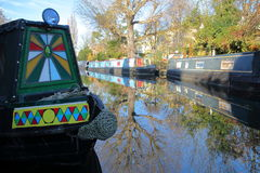 LONDON, UK: Reflections in Little Venice with colorful barges along canals Royalty Free Stock Photos