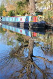 LONDON, UK: Reflections in Little Venice with colorful barges along canals Royalty Free Stock Photography