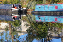 LONDON, UK: Reflections in Little Venice with colorful barges along canals Stock Photos