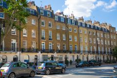 London, UK. Residential aria of Kensington and Chelsea. Cadogan gate with row of periodic buildings. Luxury prop. London, UK - August 25, 2017: Residential aria royalty free stock photography