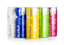 LONDON, UK - SEPTEMBER 03, 2018: Aluminium tins of Red Bull Energy Drink summer edition on white background. Red Bull is the most stock photography