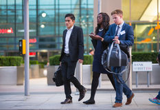LONDON, UK - 7 SEPTEMBER, 2015: Canary Wharf business life. Business people going home after working day. Royalty Free Stock Photos