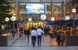 LONDON, UK - 7 SEPTEMBER, 2015: Canary Wharf business life. Business people going home after working day. Stock Photos