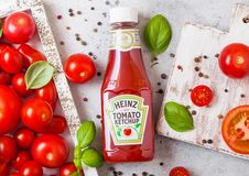LONDON, UK - SEPTEMBER 13, 2018: Heinz ketchup with fresh raw tomatoes in box on stone kitchen background. LONDON, UK - SEPTEMBER 13, 2018: Heinz ketchup with royalty free stock photo
