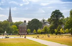 Kensington palace, in Hyde park view at sunny day with lots of people walking and resting in th, London UK Royalty Free Stock Images