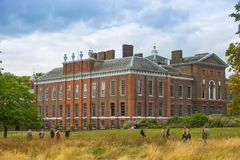 Kensington palace, in Hyde park view at sunny day with lots of people walking and resting in th, London UK. London, UK - September 8, 2016: Kensington palace, in stock photography