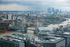 LONDON, UK - SEPTEMBER 17, 2015: London panorama with River Thames, bridges and Canary Wharf banking and business district Royalty Free Stock Photo