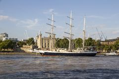 Lord Nelson sailing past the Tower of London on River Thames. London, England, UK, September 1,. LONDON, UK - SEPTEMBER 1, 2018. Lord Nelson sailing past the stock photography