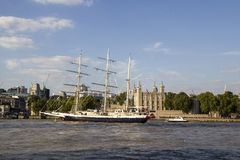 Lord Nelson sailing past the Tower of London on River Thames. London, England, UK, September 1,. LONDON, UK - SEPTEMBER 1, 2018. Lord Nelson sailing past the stock image