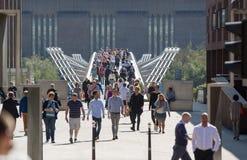 Millennium bridge with lots of walking people . London, UK Stock Photo