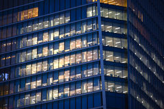 LONDON, UK - 7 SEPTEMBER, 2015: Office building in night light. Canary Wharf night life Royalty Free Stock Images