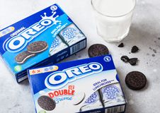 LONDON, UK - SEPTEMBER 05, 2018: Oreo cookies with glass of milk on top of kitchen background.Oreo is a sandwich cookie consisting