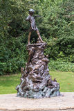LONDON, UK - September 23, 2014: Peter Pan statue in Kensington Royalty Free Stock Image