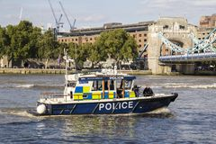 Police boat on the River Thames, London, England, UK, September 1, 2018. LONDON, UK - SEPTEMBER 1, 2018. Police boat on the River Thames, London England, UK royalty free stock photography