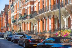 Residential aria of Mayfair with row of periodic buildings. Luxury property in the centre of London. Stock Photo