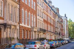 Residential aria of Mayfair with row of periodic buildings. Luxury property in the centre of London. Royalty Free Stock Photos