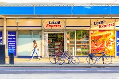 Sunlight casts a shadow on a grocery shop in Bermondsey, London. London, UK - September 5, 2017 - Sunlight casts a shadow on a grocery shop in Bermondsey with a stock photography