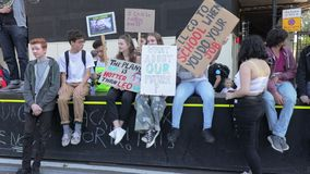 London / UK - September 20th 2019 - A group of young activists hold climate change protest signs at the Climate Strike