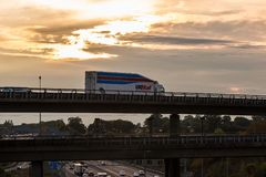 UK Mail lorry on the viaduct. London, UK - September 21, 2017: Uk Mail lorry on the viaduct over British motorway M25 during sunset Royalty Free Stock Image