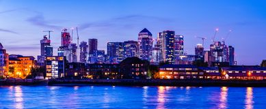 Urban night view of the downtown City of London, river Thames, modern office buildings  in the square mile financial district stock photo