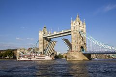 View of Tower Bridge on the River Thames opening for the Dixie Queen, Steamboat. London, England,. LONDON, UK - SEPTEMBER 1, 2018. View of Tower Bridge on the royalty free stock photos