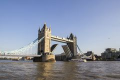 View of Tower Bridge on the River Thames opening for the passenger cruiser. London, England, UK,. LONDON, UK - SEPTEMBER 1, 2018. View of Tower Bridge on the royalty free stock photos