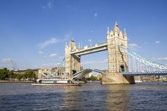 View of Tower Bridge on the River Thames opening for passing boats. London, England, UK, September. LONDON, UK - SEPTEMBER 1, 2018. View of Tower Bridge on the royalty free stock image