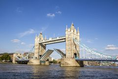 View of Tower Bridge on the River Thames opening for passing boats. London, England, UK, September. LONDON, UK - SEPTEMBER 1, 2018. View of Tower Bridge on the royalty free stock photo