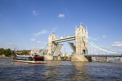 View of Tower Bridge on the River Thames opening for passing boats. London, England, UK, September. LONDON, UK - SEPTEMBER 1, 2018. View of Tower Bridge on the royalty free stock photos