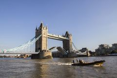 View of Tower Bridge on the River Thames opening for passing boats late afternoon. London, England. LONDON, UK - SEPTEMBER 1, 2018. View of Tower Bridge on the stock photos