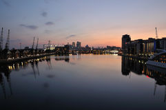 London UK skyline at dusk from Royal Victoria Dock Stock Photos