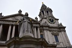 St Pauls Cathedral. Facade closeup with Queen Anne statue and tower with golden clock. London, United Kingdom, Christmas. stock images